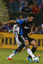 July 20, 2011; Santa Clara, CA, USA;  Vancouver Whitecaps forward Camilo Sanvezzo (37) is defended by San Jose Earthquakes defender Bobby Burling (2) during the second half at Buck Shaw Stadium. San Jose tied Vancouver 2-2.
