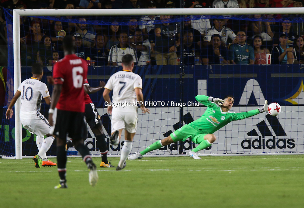Manchester United Joel Pereire, right, unable to save the ball by Los Angeles Galaxy Giovani dos Santos, left, during the second half of a national friendly soccer game at StubHub Center on July 15, 2017 in Carson, California. The Manchester United won 5-2. AFP PHOTO / Ringo Chiu