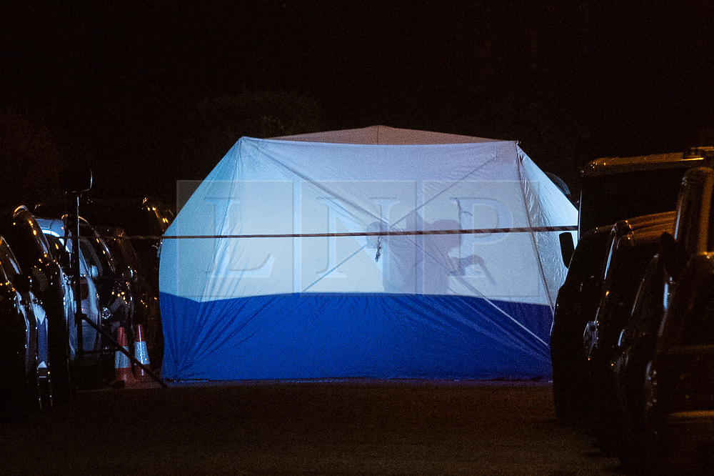 © Licensed to London News Pictures. 23/07/2020. Thame, UK. The silhouette of a forensic investigator inside a police tent as they gather evidence at the crime scene. Thames Valley Police has launched a murder investigation in Thame. At approximately  19:05BST a man was found with injuries in Chinnor Road, Thame. The 20-year-old man was pronounced dead at the scene. Photo credit: Peter Manning/LNP
