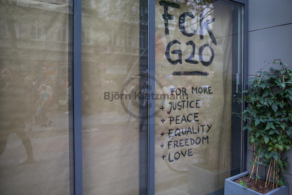 Hamburg, Germany - 05.07.2017<br /> <br /> Some shops on the route of the demonstration were barricaded for concern against riots other show anti-G20 banners in their windows.Anti-G20 rave under the slogan &rdquo;Lieber tanz ich als G20&rdquo; (&quot;I prefer to dance instead of G20&rdquo;) moves through Hamburg. According to police, about 12,000 people are involved, according to the organizers more than 25,000 people participate.<br /> <br /> Einige Geschaefte am Rande der Demonstration wurden aus Sorge vor Ausschreitungen verbarrikadiert andere befestigten Anti-G20 Banner in ihren Schaufenstern. Anti-G20 Nachttanz-Demo unter dem Motto &rdquo;Lieber tanz ich als G20&rdquo; zieht durch Hamburg. Laut Polizei beteiligen sich etwa 12.000 Personen, laut den Veranstaltern nehmen mehr als 25.000 Menschen teil. <br /> <br /> Photo: Bjoern Kietzmann