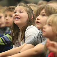 Lauren Wood | Buy at photos.djournal.com<br /> First grade students listen to Autry Davis read poetry aloud and perform Thursday morning in the library at Saltillo Primary School.