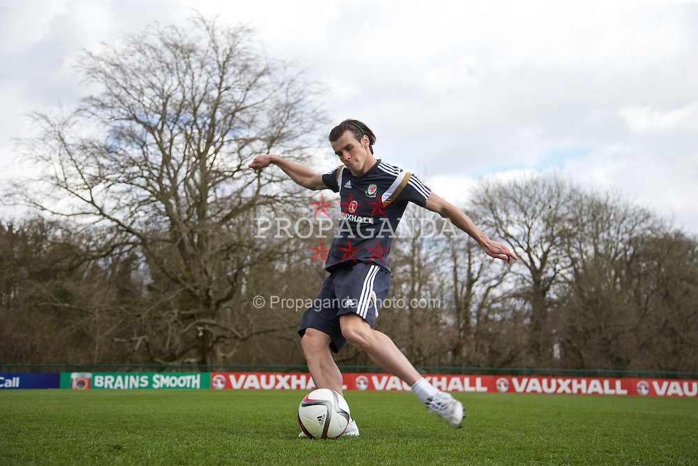 CARDIFF, WALES - Wednesday, March 25, 2015: Wales' Gareth Bale practices a free-kick during a training session at the Vale of Glamorgan ahead of the UEFA Euro 2016 qualifying Group B match against Israel. (Pic by David Rawcliffe/Propaganda)
