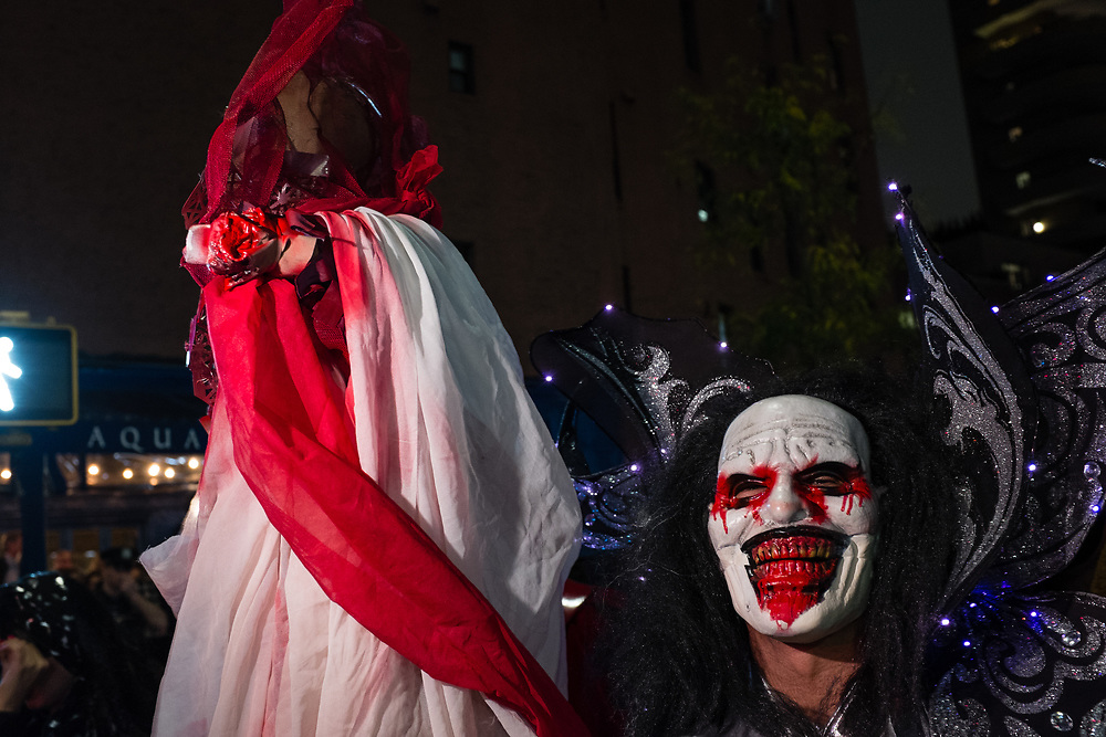 New York, NY - 31 October 2019. the annual Greenwich Village Halloween Parade along Manhattan's 6th Avenue. A blood-soaked mouth and a stark white face.