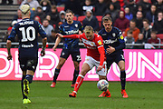 Barry Douglas (3) of Leeds United stays close to Andreas Weimann (14) of Bristol City during the EFL Sky Bet Championship match between Bristol City and Leeds United at Ashton Gate, Bristol, England on 9 March 2019.