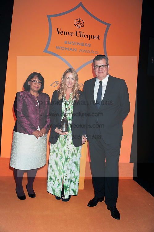 BARONESS VERMA presents the Veuve Clicquot Business Woman of the Year Award to ANYA HINDMARCH with JEAN-MARC LACAVE president of Veuve Clicquot at the annual Veuve Clicquot Business Woman of the Year Award this year celebrating it's 40th year, held at Claridge's, Brook Street, London on 18th April 2012.