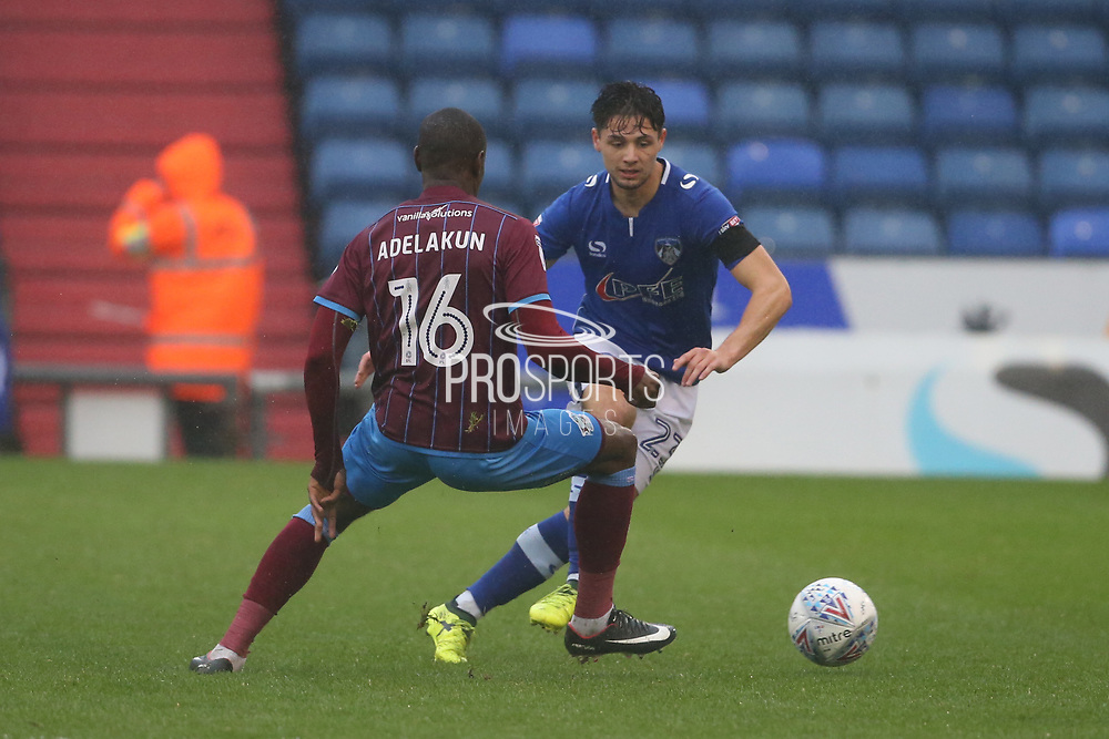 Hakeeb Adelakun Scunthorpe Midfielder attacks Gevaro Nepomuceno Oldham Midfielder during the EFL Sky Bet League 1 match between Oldham Athletic and Scunthorpe United at Boundary Park, Oldham, England on 28 October 2017. Photo by George Franks.