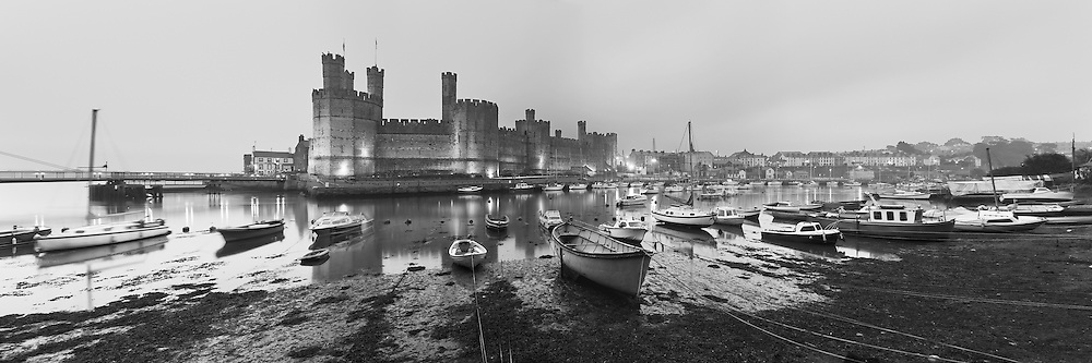 Caernarvon Castle at dusk on a cloudy summer night, Wales, Uk