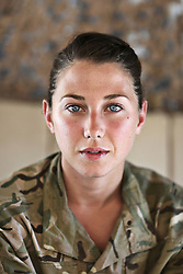 © Licensed to London News Pictures. 15/06/2012. Helmand.  Captain Alice Homer is an officer with the Royal Electrical and Mechanical Engineers.  She has just spent six months running a small section of soldiers in Camp Bastion. Army women 'engagement officers' working in Afghanistan. Trained in Pashto, the Afghan language, they accompany infantry on patrols and build relationships with Afghan women in some of the most dangerous parts of Helmand. Photo credit : Alison Baskerville/LNP