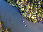 Aerial view of three kayakers in Bekal, Kerala, India.