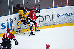 TAVZELJ Andrej vs Max Oberrauch during Alps Hockey League match between HC Pustertal and HDD SIJ Jesenice, on April 3, 2019 in Ice Arena Podmezakla, Jesenice, Slovenia. Photo by Peter Podobnik / Sportida