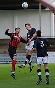 Dundee's Matty Allan outjumps St Johnstone's Chris Kane - Dundee v St Johnstone - SPFL Development League at Gayfield<br />