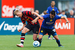July 16, 2011; San Francisco, CA, USA;  Manchester City forward John Guidetti (60) and Club America defender George Corral (34) fight for the ball during the second half at AT&T Park. Manchester City defeated Club America 2-0.