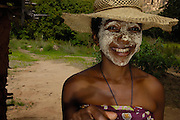 Local woman with sandalwood face mask - used as sun protection and a beautification. Isalo National Park, MADAGASCAR<br />
