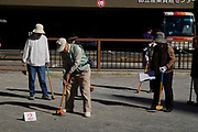 Tokyo, Japan Senior Citizens Play Croquet in a park