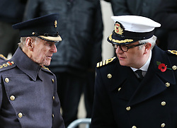 The Duke of Edinburgh with  Prince Laurent of Belgium  at the Menin Gate in Ypres, Belgium, at a ceremony on Armistice Day to mark the gathering of soil for the Flanders Fields Memorial Garden at the Guards Museum in London, Monday, 11th November 2013. Picture by Stephen Lock / i-Images