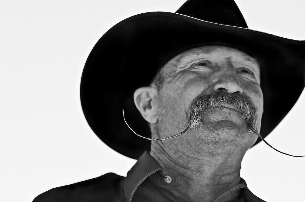 Cowboy with handlebars. Salinas Rodeo, Salinas, CA
