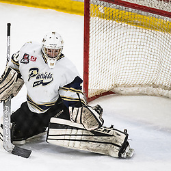 TORONTO, ON - APR 10, 2018: Ontario Junior Hockey League, South West Conference Championship Series. Game seven of the best of seven series between the Georgetown Raiders and the Toronto Patriots, Tyler Fassel #30 of the Toronto Patriots watches the puck fly just wide of the goal during the first period.<br /> (Photo by Kevin Raposo / OJHL Images)