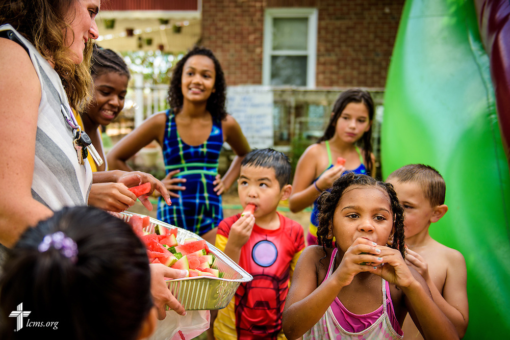 Deaconess Melissa DeGroot hands out sliced watermelon during the first domestic Mercy Medical Team on Friday, Aug. 26, 2016, at Shepherd of the City Lutheran Church in Philadelphia. LCMS Communications/Erik M. Lunsford