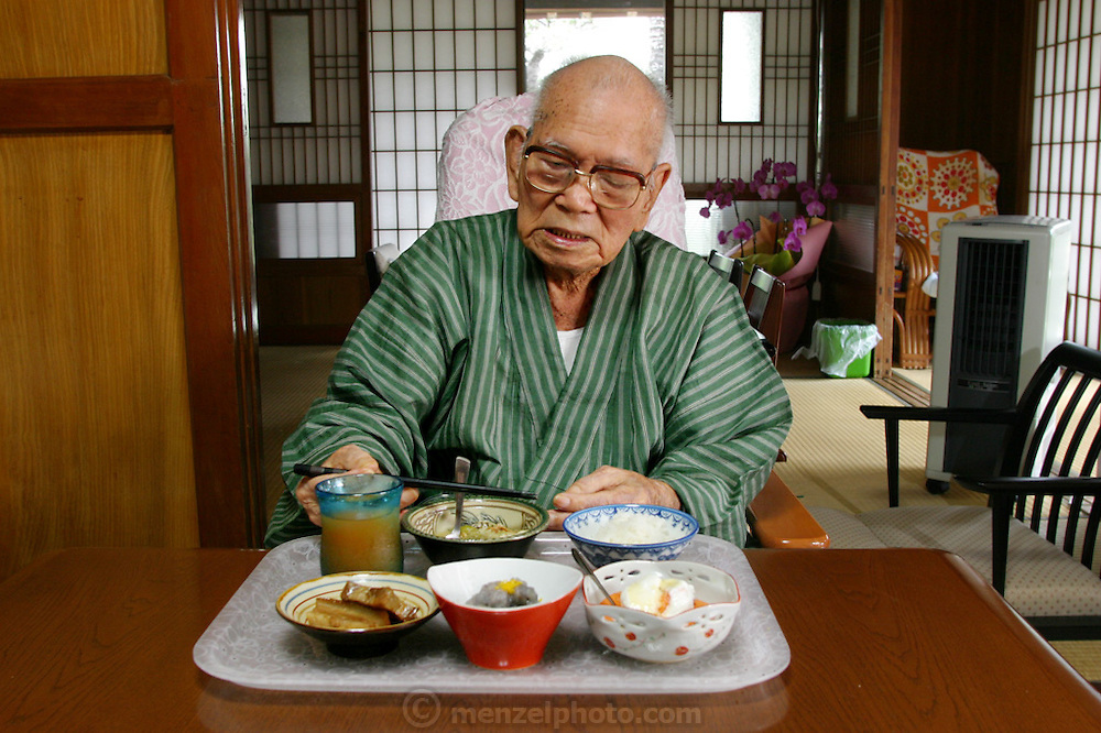 Mr. Akamine, 100, eats lunch in his Naha City home. (Supporting image from the project Hungry Planet: What the World Eats) His fellow Okinawans, the Matsuda family of Yomitan Village, Okinawa, with one of their own centenarians, is one of the thirty families featured, with a weeks' worth of food, in the book Hungry Planet: What the World Eats.
