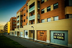 """""""Las Lomas de Arroyo"""" neighborhood.<br /> Arroyo de la Encomienda, Valladolid, Castilla y León.<br /> The recent construction boom has resulted in whole new neighborhoods like this one in the outskirts of many cities: A street grid encasing empty lots and new buildings. While in some of the buildings the occupancy rate of residential space has reached an acceptable level, the occupancy of the new commercial spaces is consistently very low."""