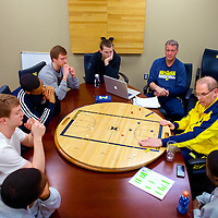 ANN ARBOR, MICHIGAN -- February 5, 2013 -- University of Michigan head coach John Beilein goes through positions with his team on a basketball court game board on game day as they prepare to take on rival Ohio State University in Ann Arbor, Michigan.  The Wolverines won 76-74 in overtime.   (PHOTO / CHIP LITHERLAND)