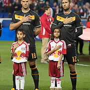 Mar 19, 2016; Harrison, NJ, USA; Houston Dynamo players stand with young fans before the game with New York Red Bulls at Red Bull Arena. Red Bulls defeat the Dynamo 4-3. Mandatory Credit: William Hauser-USA TODAY Sports