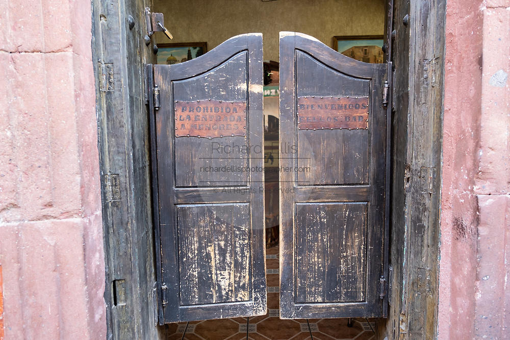 Old style swinging doors at the Fellos Bar in Atotonilco de Alto, Jalisco, Mexico. The bar has been a meeting place for tequila distillery owners and workers for more than 50-years in the tiny mountain town of Atotonilco de Alto, home to Siete Leguas, Don Julio and Patron tequila brands.