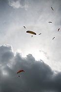 Paragliders thermal up to the clouds. Valle de Bravo, Mexico.