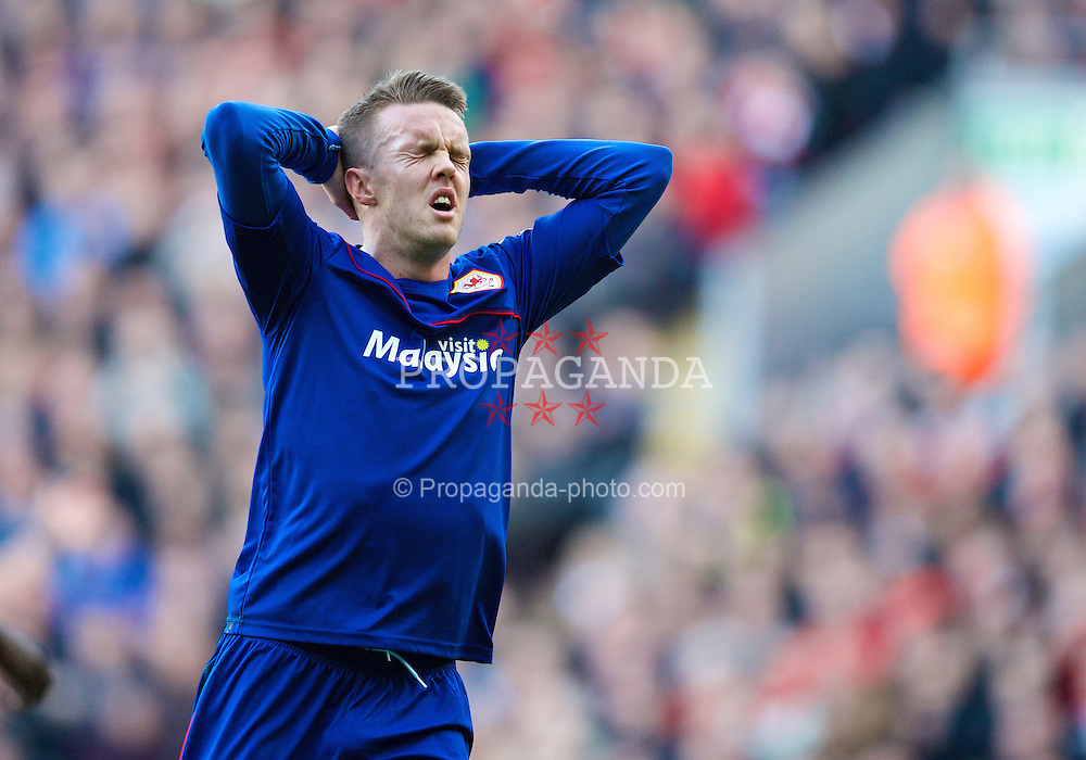 LIVERPOOL, ENGLAND - Saturday, December 21, 2013: Cardiff City's Craig Noone looks dejected after missing a chance against Liverpool during the Premiership match at Anfield. (Pic by David Rawcliffe/Propaganda)
