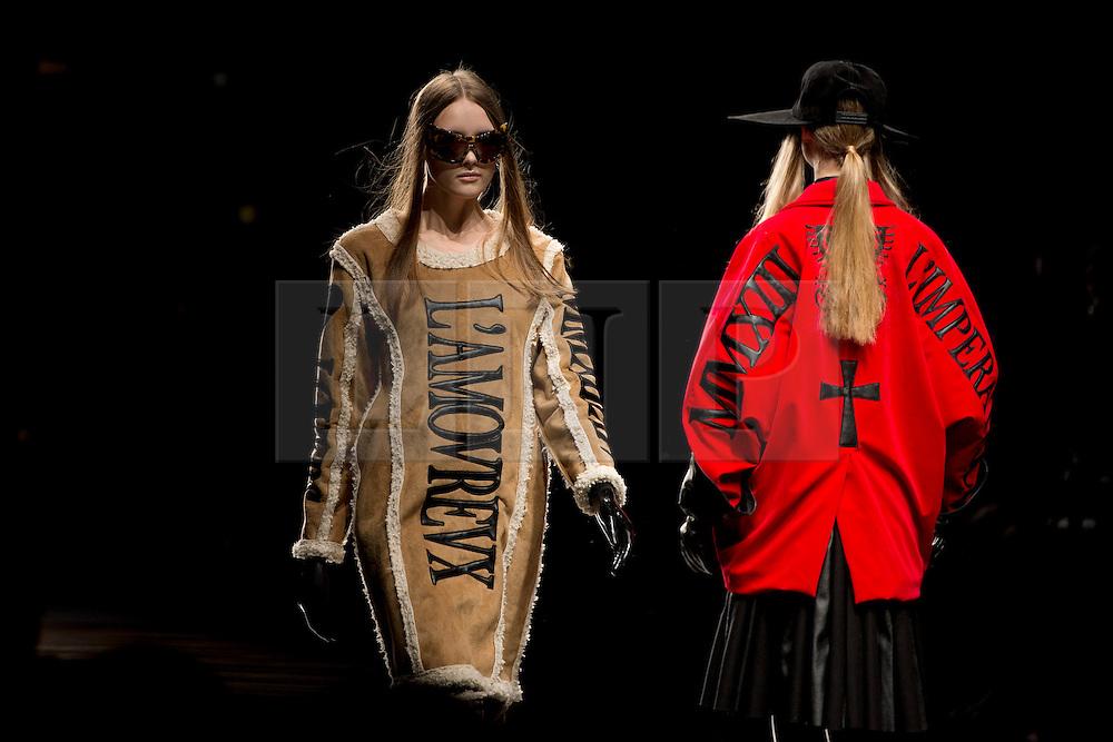 © London News Pictures. 15/02/2013. London, UK. A model walks the runway at the KTZ show by designers Marjan Pejoski  and Koji Maruyama  at London Fashion Week Autumn Winter 2013/14 on February 15, 2013. Photo credit : Ben Cawthra/LNP