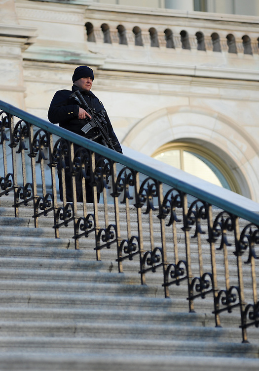Ronney Schorah guards the steps on the west side of the Capitol before the State of the Union address on Wed. Jan. 27, 2010. (Amanda Lucidon/For The New York Times)