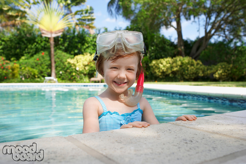 Girl (5-6) snorkelling in swimming pool portrait