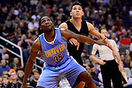 Jan 28, 2017; Phoenix, AZ, USA; Denver Nuggets forward Kenneth Faried (35) boxes out Phoenix Suns guard Devin Booker (1) in the second half of the NBA game at Talking Stick Resort Arena. The Nuggets won 123-112. Mandatory Credit: Jennifer Stewart-USA TODAY Sports