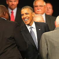 President Barack Obama shakes hands with members of the gallery after delivering remarks at the Disabled American Veterans  National Convention at the Orlando Hilton Ballroom in Orlando, Florida on Saturday, August 10, 2013. (AP Photo/Alex Menendez)
