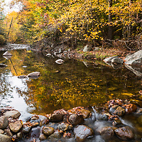 Beautiful reflections of autumn colors at Scuptured Rocks State Geologic Area, NH