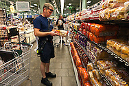 A firefighter shops for ingredients for breakfast.