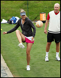 Maria Sharapova playing football during Training at the Wimbledon Tennis Championships<br /> Tuesday, 25th June 2013<br /> Picture by Andrew Parsons / i-Images