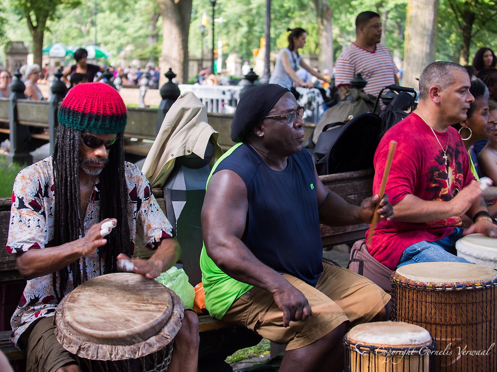 Every weekend a community of Djembe drummers and other percussionists come together near the Bandshell in Central Park to play and dance.