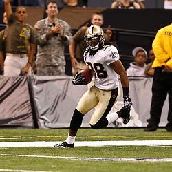 August 27, 2010; New Orleans, LA, USA; New Orleans Saints safety Usama Young (28) runs back an interception during the second half of a preseason game at the Louisiana Superdome. The New Orleans Saints defeated the San Diego Chargers 36-21. Mandatory Credit: Derick E. Hingle