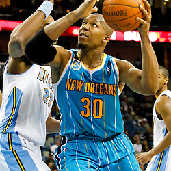 October 29, 2010; New Orleans, LA, USA; New Orleans Hornets power forward David West (30) drives past Denver Nuggets power forward Shelden Williams (23) during the third quarter at the New Orleans Arena.  Mandatory Credit: Derick E. Hingle