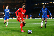 Bayern Munich forward Kingsley Coman chases the ball with Chelsea defender Antonio Rudiger and Chelsea defender Marcos Alonso closing him down during the Champions League match between Chelsea and Bayern Munich at Stamford Bridge, London, England on 25 February 2020.