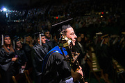 Faculty Senate chair Joseph McLaughlin holds the ceremonial mace at undergraduate commencement. Photo by Ben Siegel