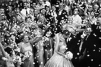 rose petals thrown in celebration of bride & groom kissing after wedding vows at the mission inn in riverside
