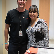 OCTOBER 6, 2017--MAYAGUEZ, PUERTO RICO ---<br /> Dolores Morales, center, Executive Director of Migrant Health Center  and Damon Taugher as she receives medical supplies from Direct Relief following the path of Hurricane Maria through Puerto Rico.<br /> (Photo by Angel Valentin/Freelance)