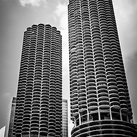 Chicago Marina City Towers in black and white. Marina City consists of two round corncob shaped mixed-use buildings located along the Chicago River in downtown Chicago.