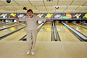 """Sylvia Price celebrates a strike during the first day of competition in the 6-month-long """"Mostly Mrs."""" women's bowling league the morning of October 5 at Cedar House Bowling Center."""