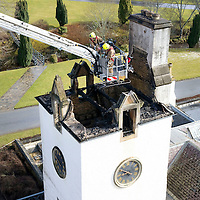 Blair Atholl Castle Fire...11.03.11     Tayside Firefighters still working on the clock tower at the castle which caught fire last night, checking for and damping down hotspots..<br /> Picture by Graeme Hart.<br /> Copyright Perthshire Picture Agency<br /> Tel: 01738 623350  Mobile: 07990 594431