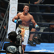 Gary Antuann Russell celebrates after he knocks out Joe Esquivel in the first round during a Premier Boxing Champions fight on Saturday, August 4, 2018 at the Nassau Veterans Memorial Coliseum in Uniondale, New York.  (Alex Menendez via AP)