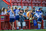 Aileen Whelan (Brighton), Megan Connolly (Brighton) & Maya Le Tissier (Brighton) signing autographs and talking with young supporters following the FA Women's Super League match between Brighton and Hove Albion Women and Chelsea at The People's Pension Stadium, Crawley, England on 15 September 2019.