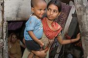 Jiannatnisha Shaikh with her son Sanua Shaikh in her home by Bandra Station, Mumbai, India